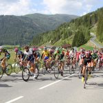 Cyclists Racing in Mountains